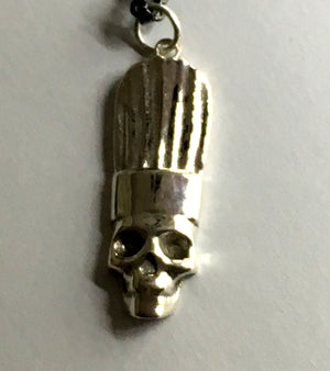 close up of chef skull pendant