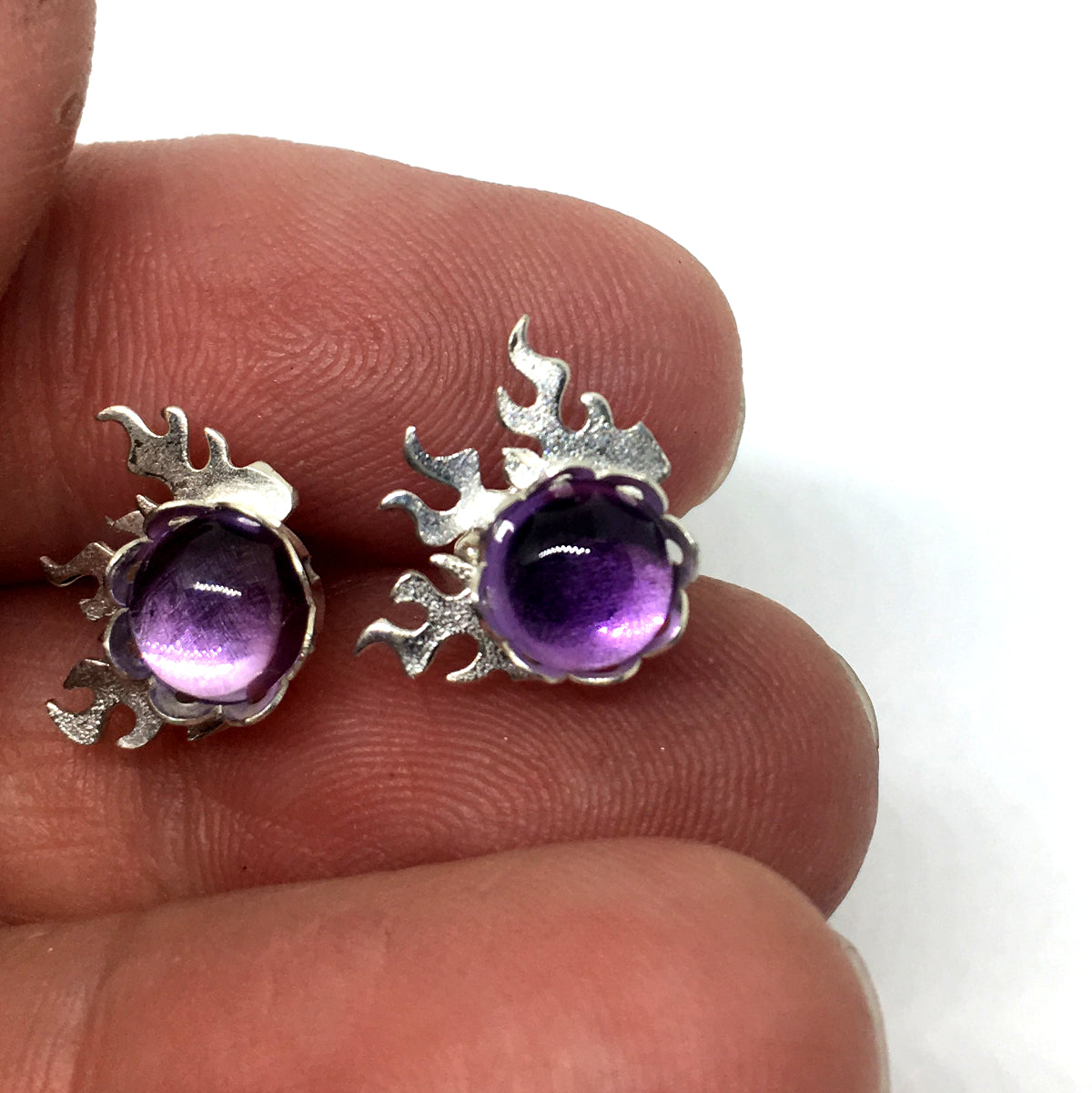 6mm round amethyst are bezel set