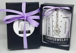 custom chef jewelry packaging tied up with ribbon