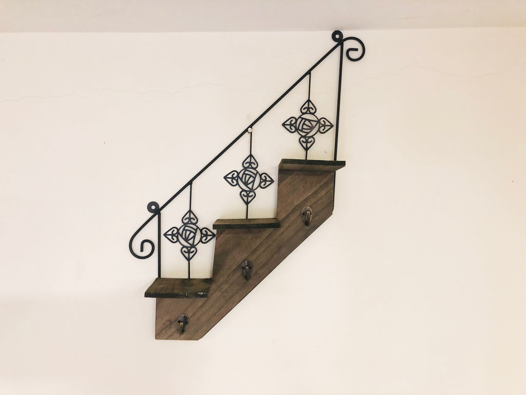Wall mounted staircase shelf