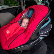 baby parka red car seat cover shown with newborn in car seat in vehicle