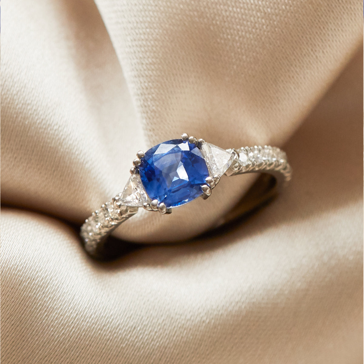 Cushion Cut Blue Sapphire Trilogy Engagement Ring from Fenton in Platinum