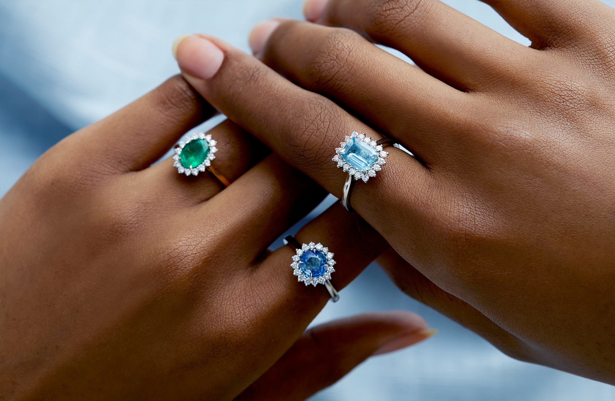 The Star Rings from Fenton - emerald, blue sapphire and aquamarine set in 18kt gold and platinum with a halo of diamonds.