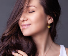 Gold Earrings With 5 Pointed Star Symbol - Worn On Ear
