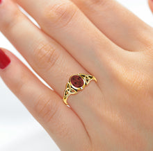Woman wearing Trinity Genuine Garnet January Birthstone Ring