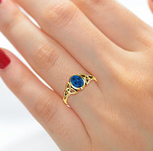 Woman wearing Trinity Style Sapphire Sept Birthstone Ring