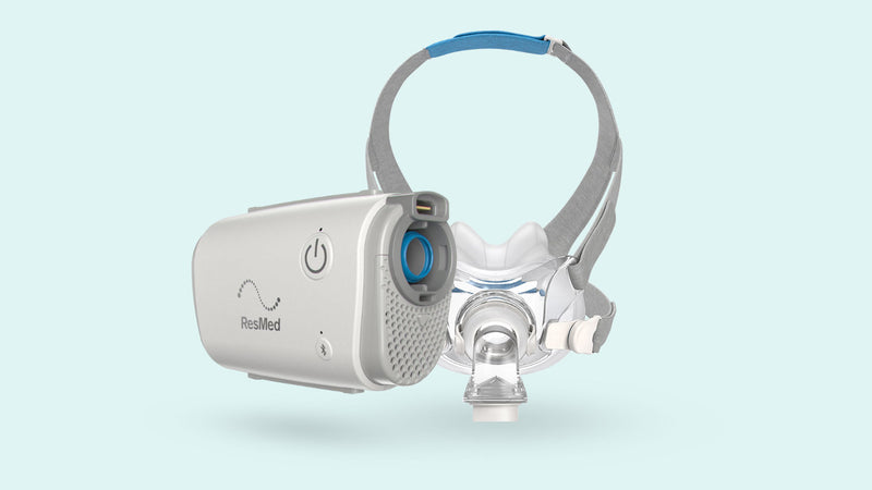 The ResMed AirMini 10 with the ResMed AirFit full face mask.