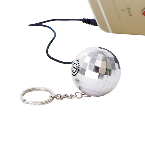 silver disco ball phone speaker connected to iphone