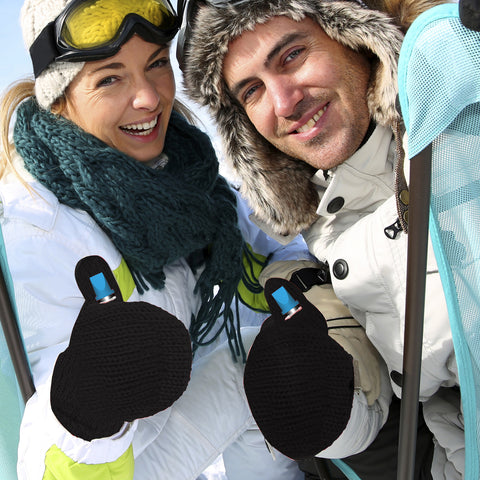 an image of a man and a woman wearing white coat and black flask mitten