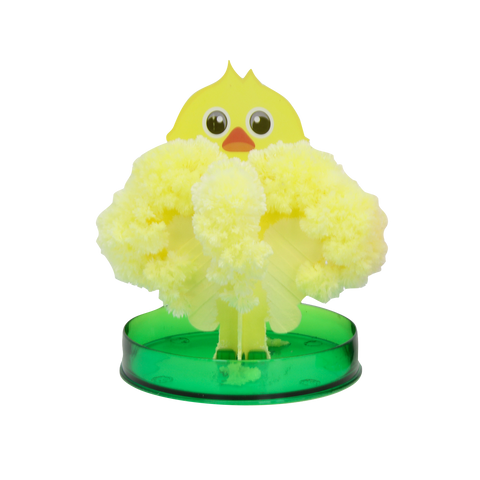 yellow easter chick magic grower standing on a green circular container