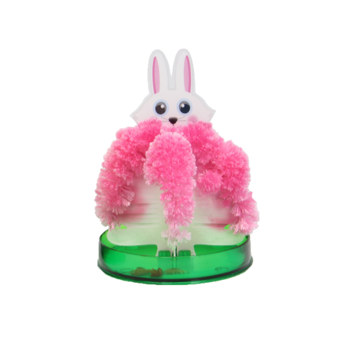 easter bunny magic grower standing on a green circular container