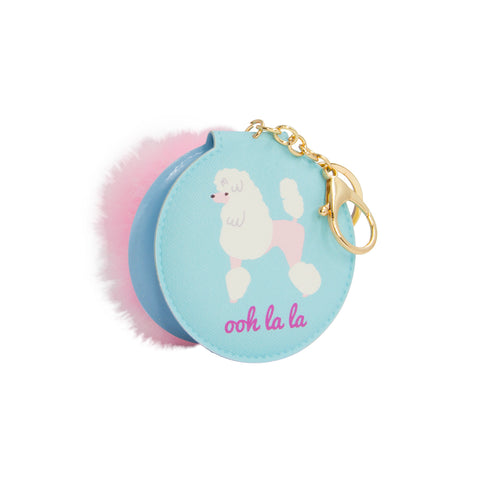 small mirror with cover of poodle and text of oh la la comes in a keychain with pink pom pom
