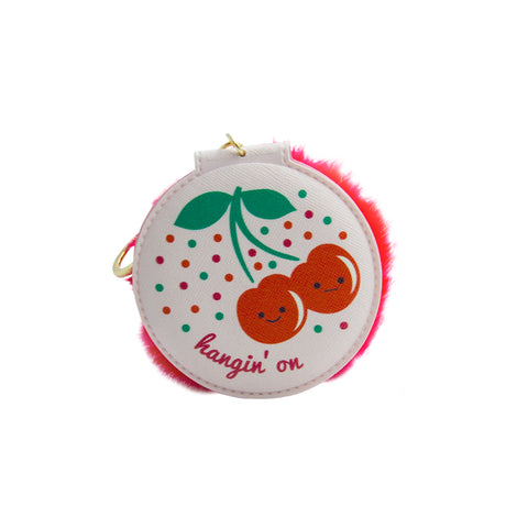 compact mirror with cover of two cherries and text of hanging on comes in a keychain with red pom pom