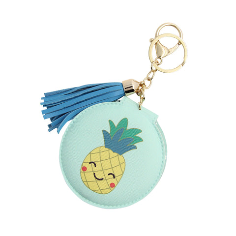 a sky blue cover compact mirror with printed pineapple comes in a keychain with blue tassel