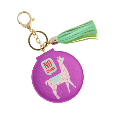compact mirror with purple cover of llama with a text of no drama comes in a keychain with green tassel