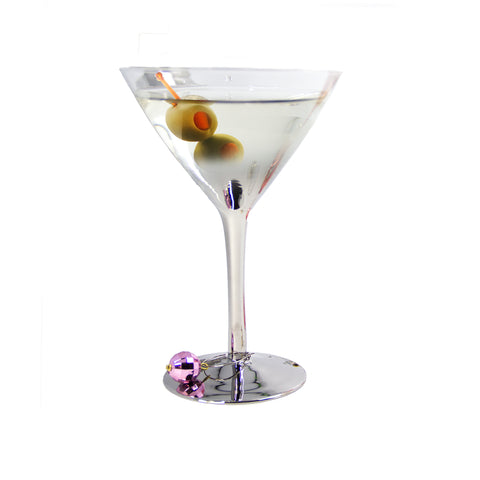 silver ombre martini glass filled cocktail and two olive with purple glass charm on glass base