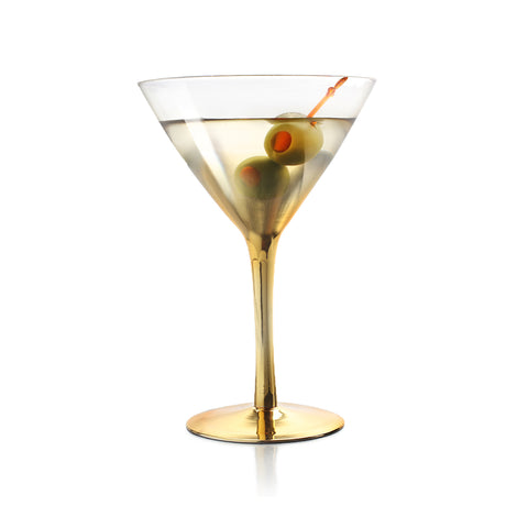 gold ombre martini glass filled with cocktail and two olive