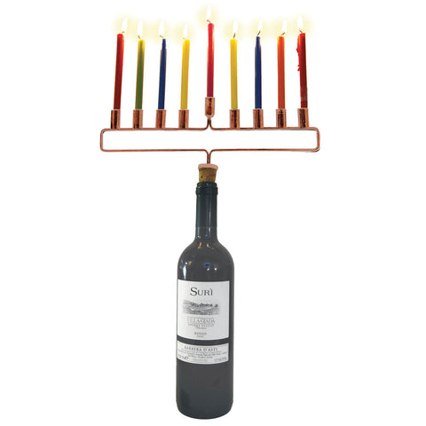 a bottle of wine covered with menorah wine bottle cork with 9 lighted candles