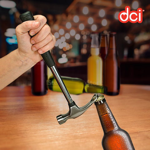 a hand using the hammer bottle opener removing a bottle cap on a bar set up background