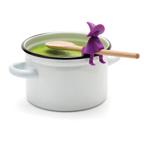 pot filled with green soup with spoon on edge with agatha spoon holder