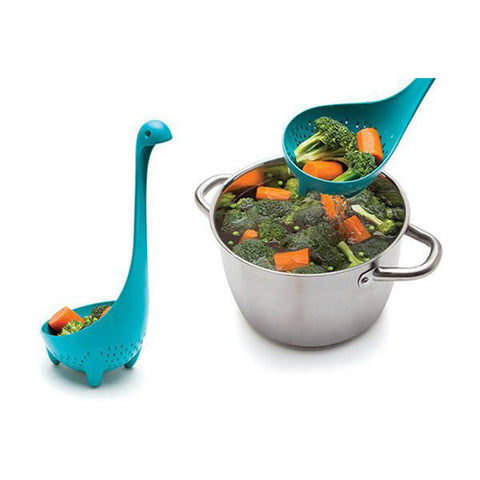 mama nessie colander spoon filled with vegetables and cooking pot filled with vegetables