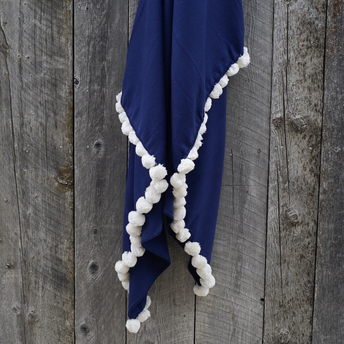 Indigo pom pom throw