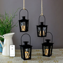 4 Black Mini Flameless Lanterns with 4 Ivory Resin Votive Candles, Warm White LEDs, Matte Finish, Indoor/Outdoor Use, Batteries & Remote Included