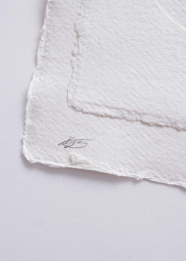 Close-up of signature on the front of a Kelly Jay geometric collage.