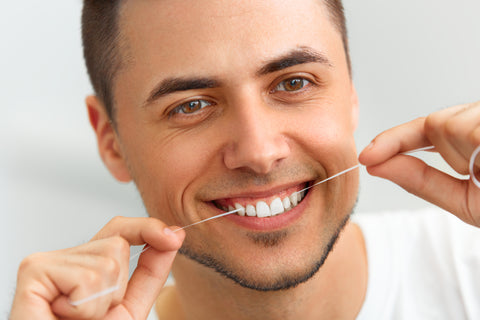 7 Reasons To Floss That Go Beyond Dental Health