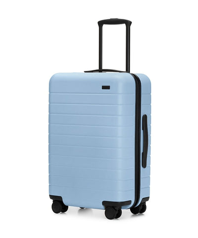 The Bigger Carry-On Suitcase in sky-blue color - gift ideas for your girlfriend from women-owned businesses
