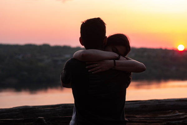 couple hugging at sunset