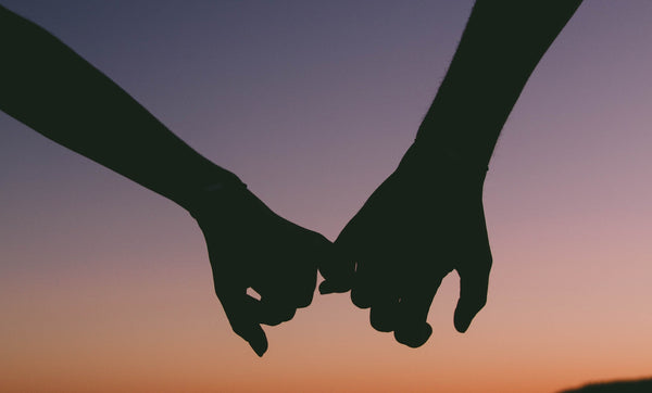 couple holding hands, with different libidos