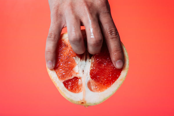 fingers inside grapefruit