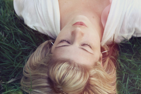 Girl sleeping in the grass - how cannabis can improve sex and pleasure