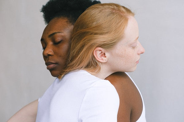two women embracing affectionately