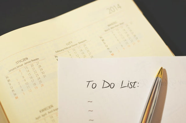 To do list written on a paper with calendar