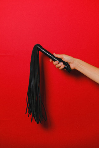 whip over red background