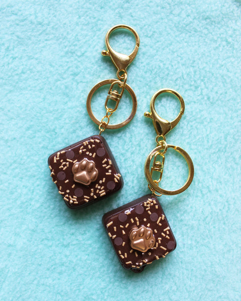 Cookie Dough Brownie Bites with Gold Paw Decorations