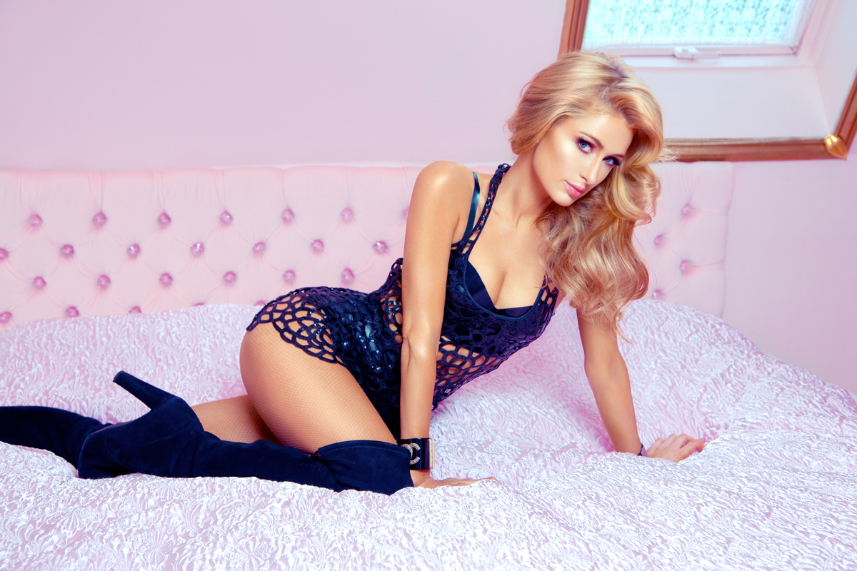 Paris Hilton posing on a bed