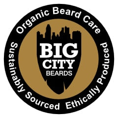 Round Organic Beard Care logo for Big City Beards. It features the company crest in the middle on a gold backdrop with a black outer ring. Within the black outside ring is the following test: Organic Beard Oil. Sustainably Sourced. Ethically Produced.