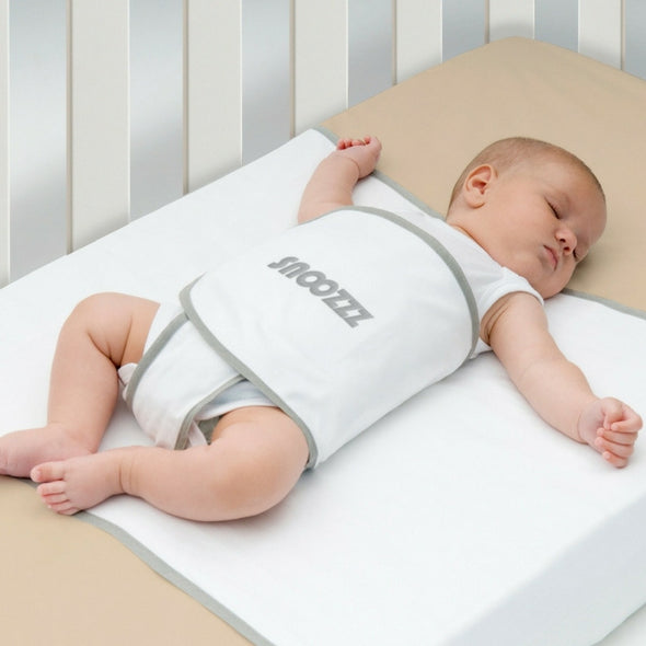 Snoozzz Baby wrap can give your child a sense of security while reducing the risk of Tummy Sleeping, Climbing out of bed at night, Sliding under bedding, Flattened head (plagiocephaly)