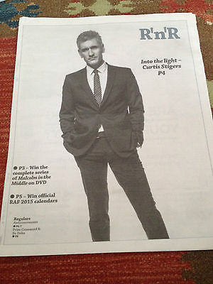 CURTIS STIGERS PHOTO COVER INTERVIEW DEC 2014
