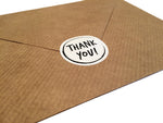 Thank you sticker on back of paper envelope