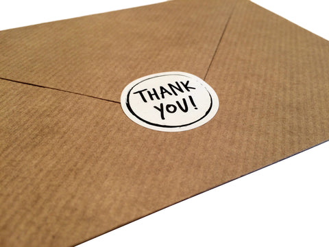 Thank you sticker on kraft envelope