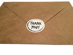 Thank you label on paper envelope