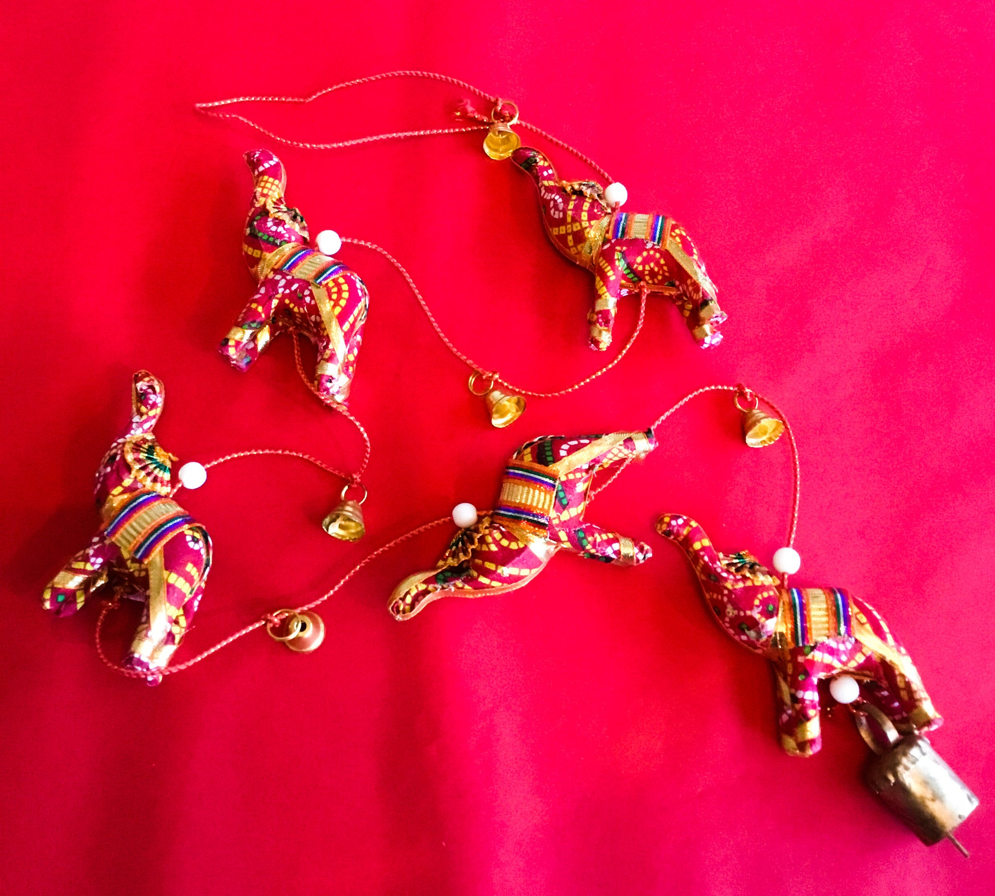 String of 5 mini gilded elephants with bells