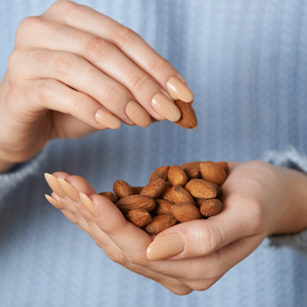 Handful of Australian Almonds representing recommended 30 grams of nuts a day
