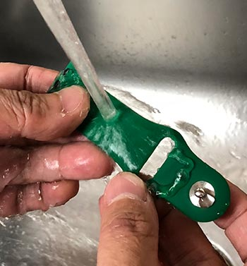Clean Silicone Band Under Running Water