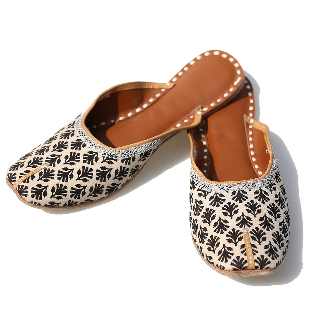 Open Black Floral with White Coloured Blockprinted Leather Mojris from Kutch