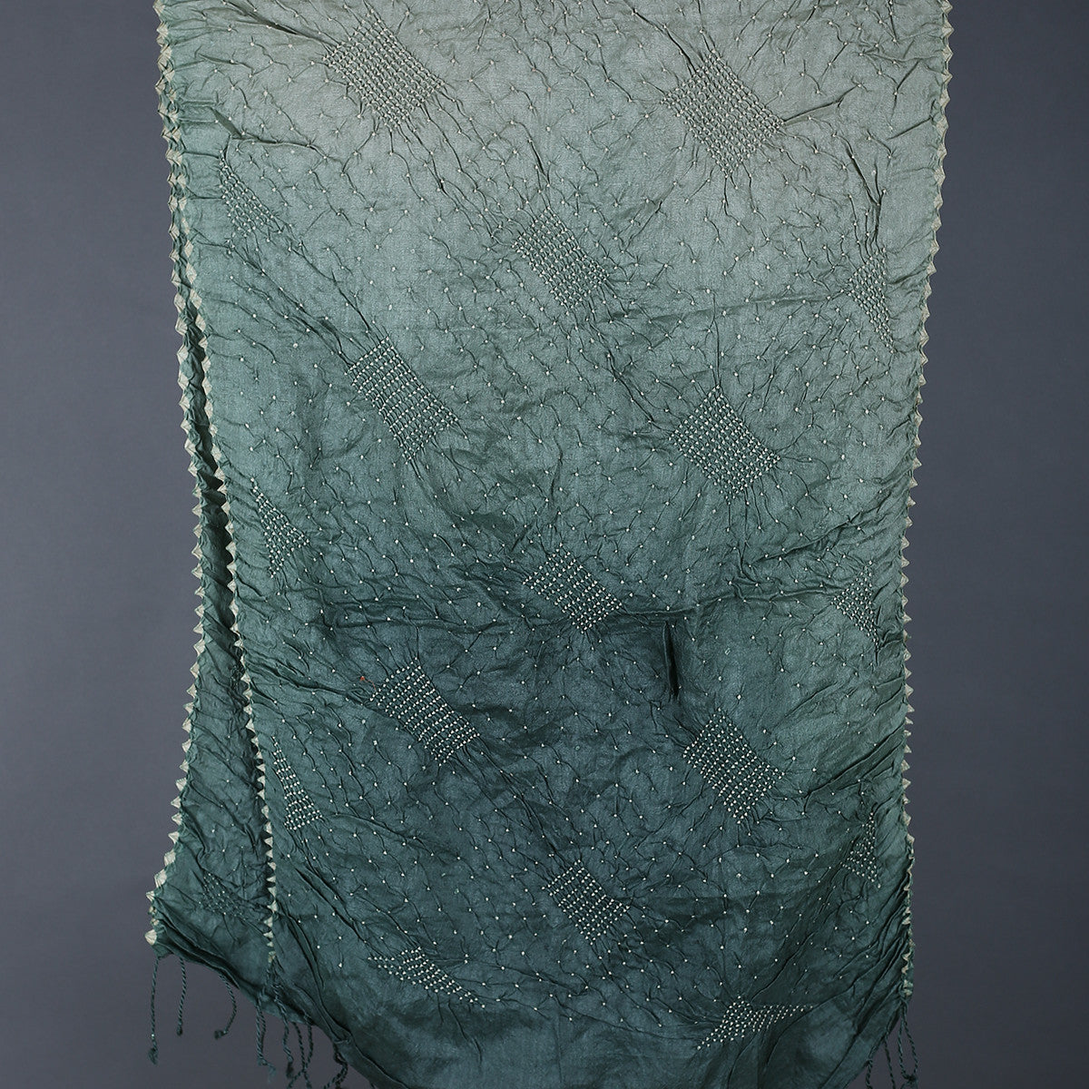 Green coloured Kutch Bandhni Stole in Tussar Silk with box design